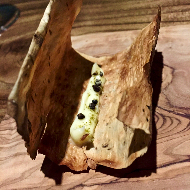 "Burdock root ""bark"", butter, kombu, sansho berry. Flipped to show underside."
