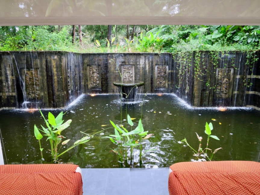 In-villa private massage tables next to waterfall